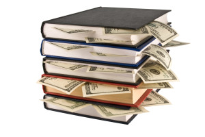 bigstock-Dollars-in-the-books-4201911