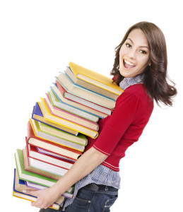 bigstock-Girl-with-pile-color-book--Is-21192884