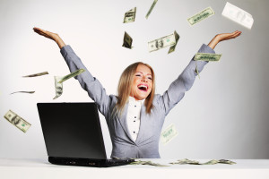 bigstock-business-woman-drop-dollars-in-25447745