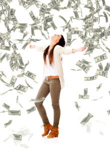 bigstock-Excited-woman-under-a-money-ra-41685316